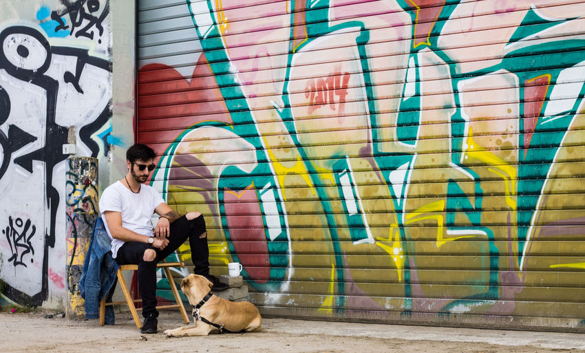 Shooting with a smart guy and his lovely dog BSide Color Portrait DogLove EyeEm Best Shots Graffiti Badboy Colorful Day Dog Dogandman Guyswithtattoos Hipster Ms4l People Sexyman Sexymen Tattoo Tattooman