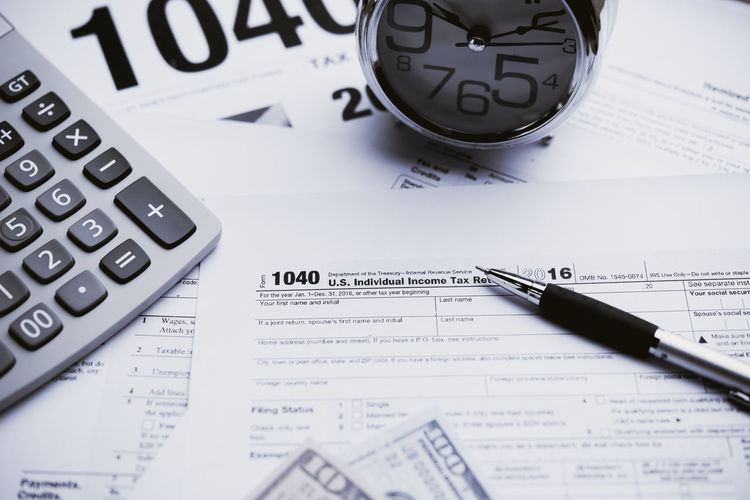 Calculator Paper Still Life Pen Finance Number No People High Angle View Text Document Close-up Indoors  Business Writing Instrument Education Mathematics Selective Focus Communication Table Financial Figures Paperwork