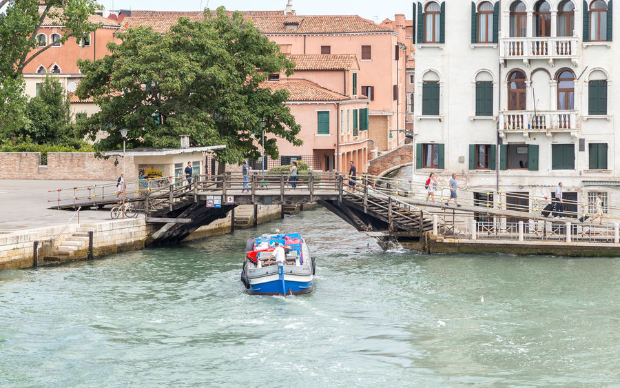 Venice transport system... Venice Canals Venice Italy Venice Taxi Venice Water Taxi Venice, Italy Adult Architecture Boat Boats Building Exterior Day Italy Men Nature Nautical Vessel Outdoors People Real People Tourist Destination Transportation Travel Destinations Venice Venice View Water Waterfront