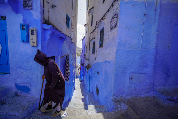 """""""The Blue City"""" - A day in the life in Chefchaouen Chefchaouen Chefchaouen Medina Chefchaouen Blue City Morocco Travel Destinations Travel Travel Photography Digital Nomad Tourism Tourist Attraction  Tourist Destination EyeEmNewHere EyeEm Best Shots Architecture Built Structure Building Exterior Real People One Person Building Full Length Lifestyles City Leisure Activity Men Day Clothing Walking Wall - Building Feature Residential District Footpath Women Street Outdoors Alley Obscured Face"""