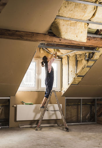 Woman standing in abandoned building