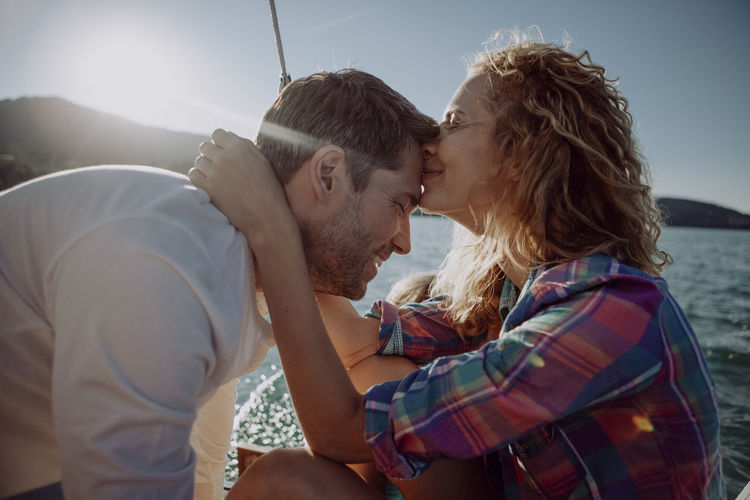 Young couple kissing in water