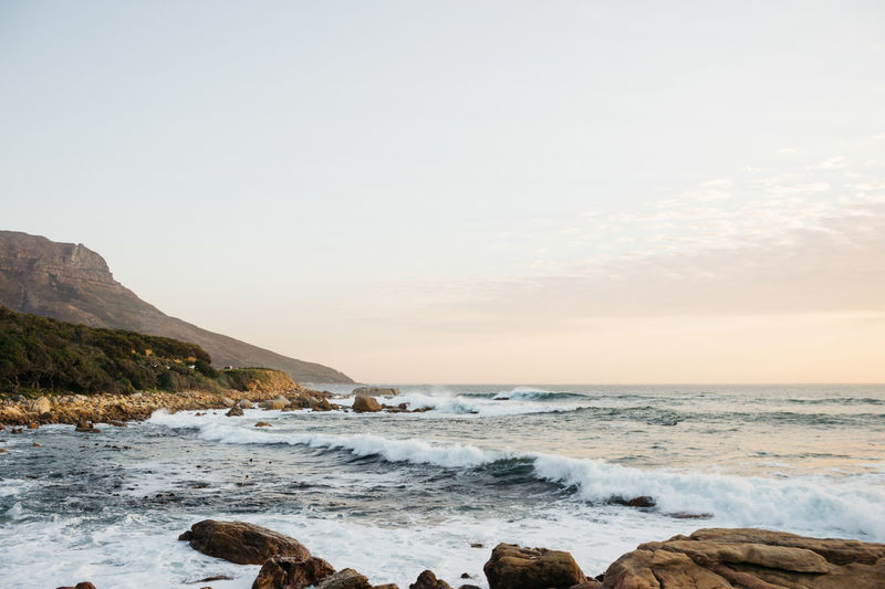 The Coastal Road. Just off the Atlantic Ocean in Cape Town - a series. Mid July, 2018. Sea Water Sky Beauty In Nature Scenics - Nature Rock Wave Motion Horizon Over Water Beach Horizon Land Rock - Object Nature Solid No People Aquatic Sport Sport Tranquility Outdoors Power In Nature Flowing Water Cape Town South Africa Jonnynichayes Ocean Wave Waves Blue Mountain Mountain Range Rocks Popular Photos My Best Photo My Best Travel Photo Coastline Coast Evening Sunset Sunset_collection Beautifulinnature
