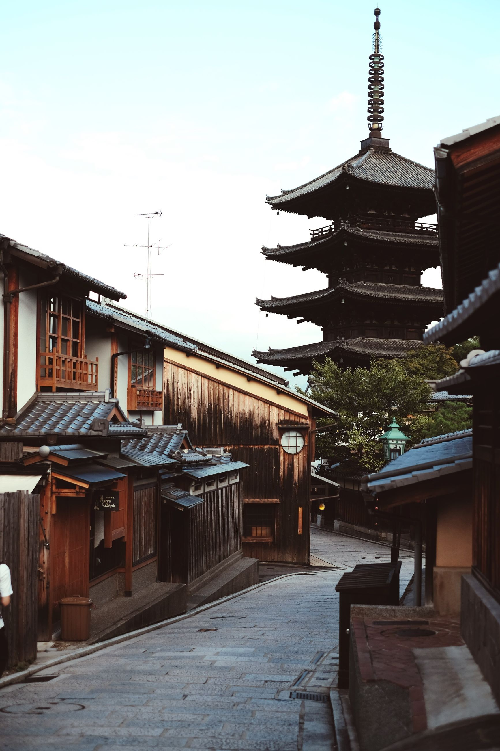building exterior, architecture, built structure, residential building, clear sky, residential structure, city, day, culture, footpath, sky, outdoors, no people, asian culture, town, famous place, exterior, leading