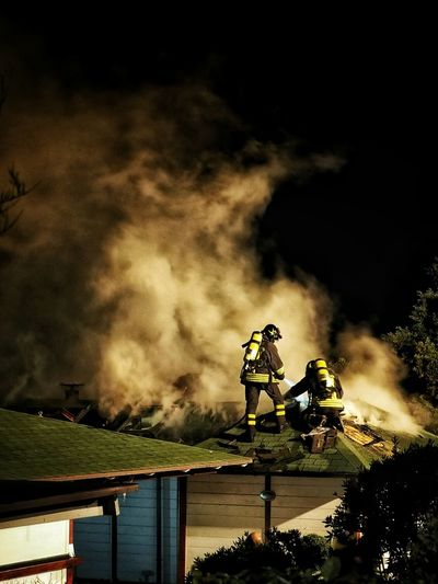 Firefighters at work against smoke