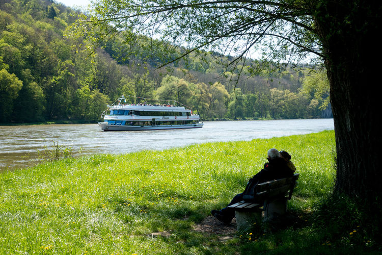 Panoramaweg between Kehlheim and Weltenburg Day Donau Donauschifffahrt Forest Full Length Grass Green Color Hicking Kehlheim Nature One Person Outdoors Panoramaweg People River Schiff Ship Sitting Sky Transportation Trecking Tree Wanderlust Wandern Weltenburger Panoramaweg
