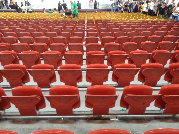Concert Stadium Seating Grand Stand Seat Red In A Row Arrangement Group Of People Side By Side Empty White Line Theater