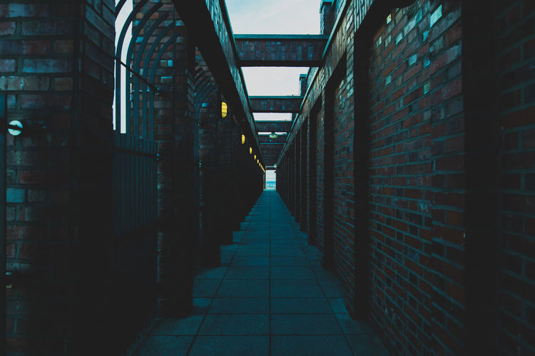 Alley Arcade Architecture Brick Brick Wall Building Building Exterior Built Structure City Corridor Day Diminishing Perspective Direction Footpath Narrow No People Outdoors The Way Forward Wall Wall - Building Feature