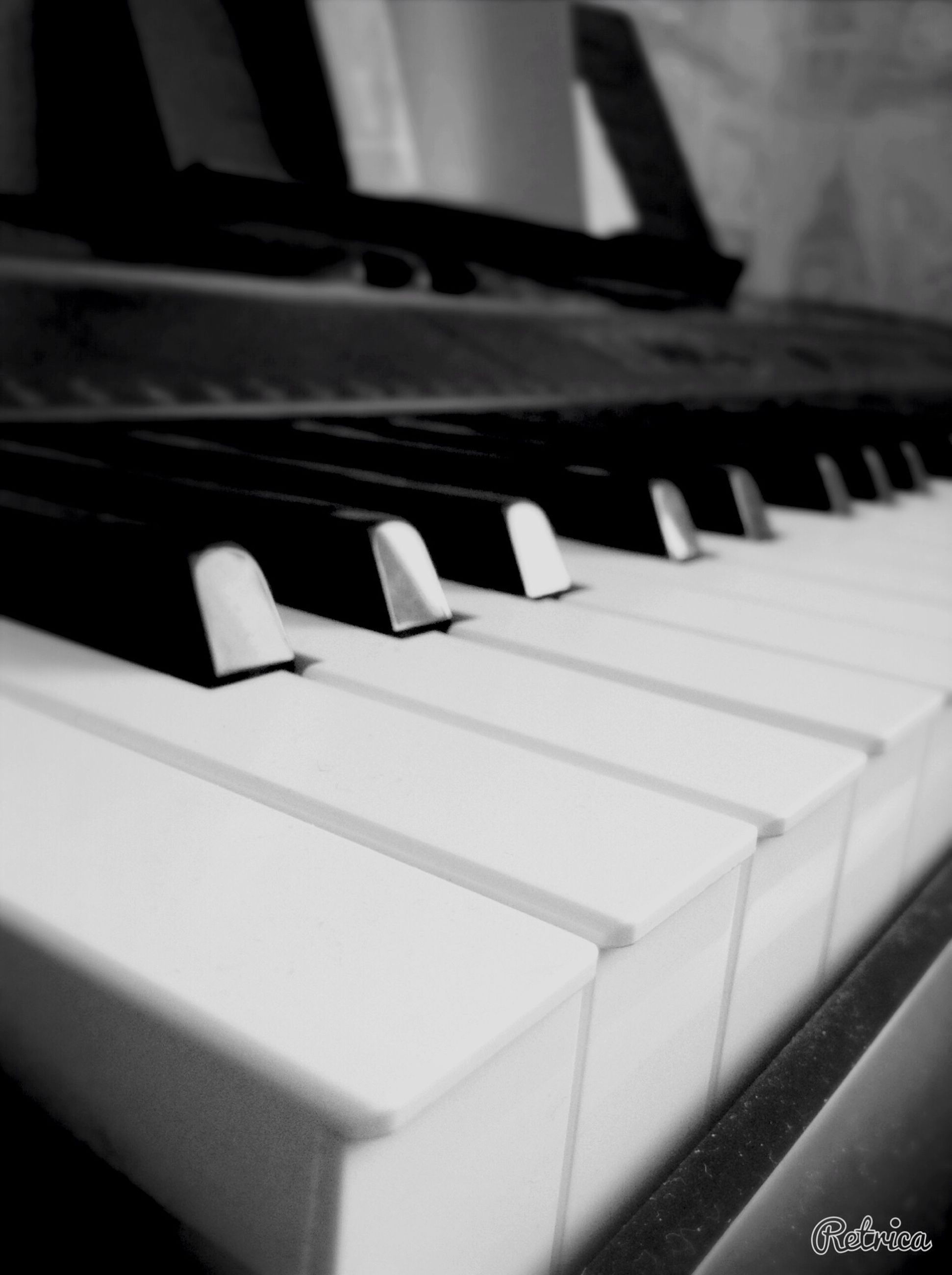 indoors, piano key, piano, close-up, music, in a row, high angle view, arts culture and entertainment, musical instrument, no people, repetition, selective focus, steps, staircase, shadow, pattern, focus on foreground, musical equipment, part of, steps and staircases