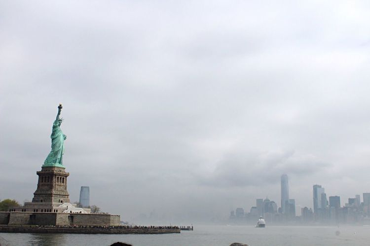 Lady Liberty Water Skyline View Liberty Island Canon Canonphotography Architecture Sky Sculpture Statue Built Structure Cloud - Sky Water Freedom No People EyeEmNewHere The Traveler - 2018 EyeEm Awards