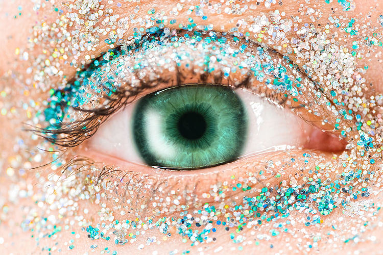 Macro green female eye with glitter eyeshadow, colorful sparks, crystals. Beauty background, fashion glamour makeup concept. Holiday evening make-up detail. Eye Sensory Perception One Person Human Body Part Eyesight Human Eye Body Part Close-up Blue Eyes Adult Looking At Camera Women Eyelash Real People Young Adult Portrait Unrecognizable Person Iris - Eye Extreme Close-up Human Face Beautiful Woman Turquoise Colored Obscured Face