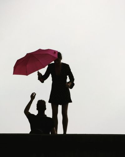 rain comes down. Adult Bonding Clear Sky Day Friendship Full Length Holding Lifestyles Love Low Angle View Outdoors People Protection Real People Sky And Clouds Standing Togerherness Two People Under Women Young Adult EyeEm Selects Mix Yourself A Good Time