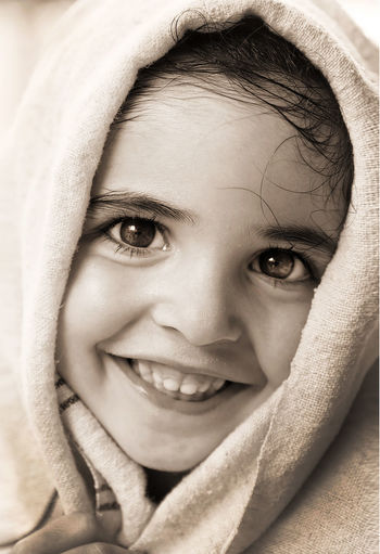 Close-Up Portrait Of Cute Girl Wrapped In Towel