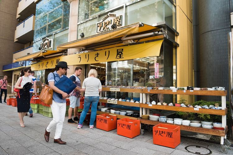 City Men Architecture Communication Text Building Exterior EyeEmNewHere Adult Street Women Sign Group Of People Real People Built Structure Leisure Activity Retail  Lifestyles City Life Business People Store