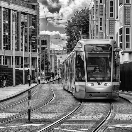 Architecture Building Building Exterior Built Structure City City Life City Street Cloud Cloud - Sky Cloudy Day Diminishing Perspective Empty LUAS Mode Of Transport No People Outdoors Railroad Track Residential Building Sky The Way Forward Vanishing Point