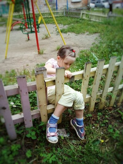 """""""Profitable busines"""" Girl Child Childhood Playgarden Fence Hole In Fence Yard Playing Fun Summer August"""