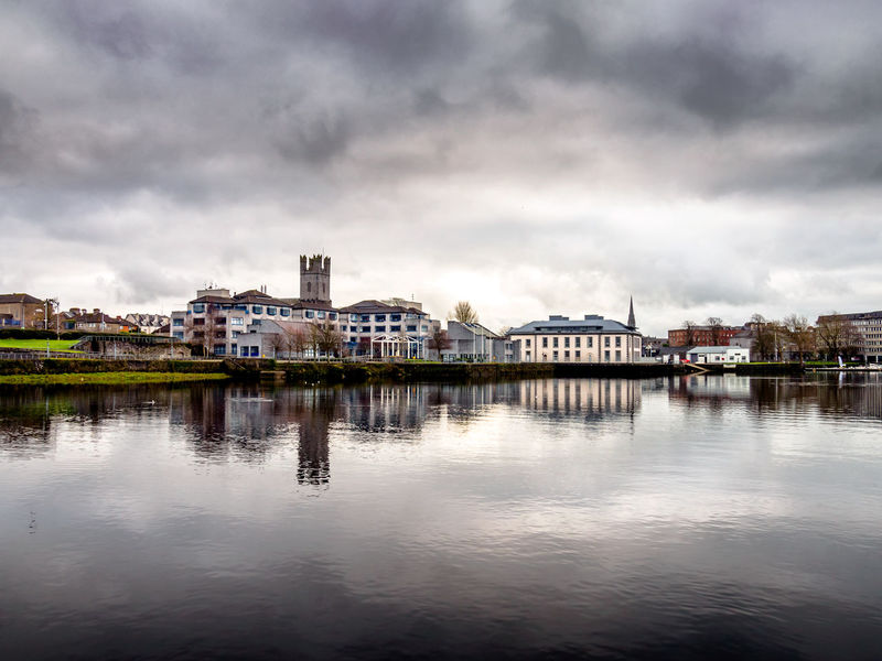 Kings Island Limerick City Ireland Reflection Water Architecture City Travel Destinations Outdoors Sky Cloud - Sky Cityscape Building Exterior Built Structure No People Nature Urban Skyline Day River Shannon River Limerick