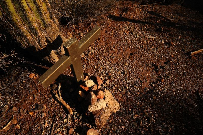 Unmarked grave in the massacre grounds trail Desert Cactus Respectful Religious  Cross Unmarked Graves High Angle View Sunlight Nature No People Day Shadow Outdoors Land Directly Above Close-up Full Frame Sand Textured  Pattern