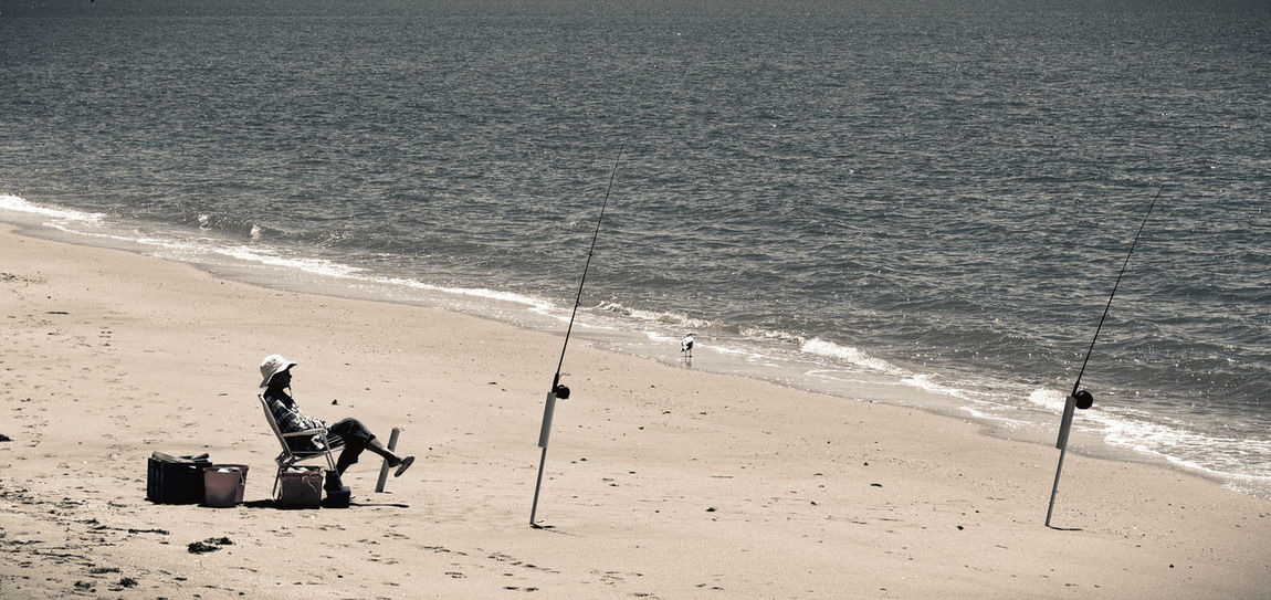 Fishing at the beach Beach Beachphotography Coastline Escapism Fisherman Fishing Getting Away From It All Leisure Activity Ocean One Person Outdoors Recreational Pursuit Relaxing Sand Sea Seascape Seaside Shore Summer