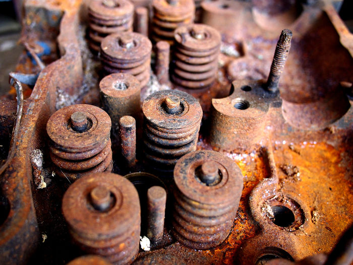 old, broken and rusty automobile engine at a junk or scrap yard Automobile Car Vehicle Interior Engine Engineering Motor Vehicle Rust Rusty Corrosion Old Junk Junkyard Scrap Scrap Metal Scrapyard Cylinder Piston Metal Industry Industry Work Tool Workshop Rusty Factory Metal Tool Bolt Machine Recycling Center Garbage Dump Waste Management