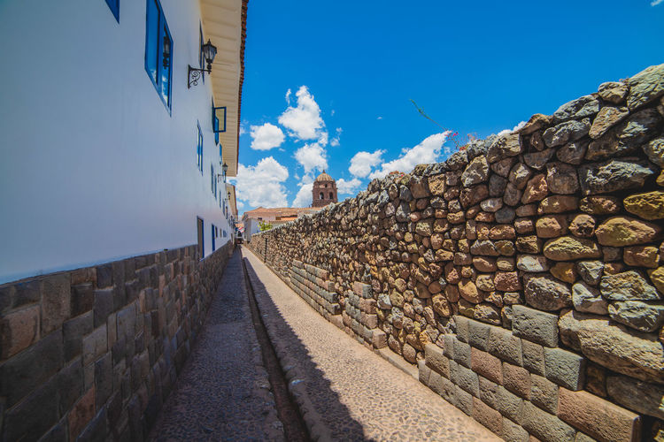 Panoramic view of wall against blue sky