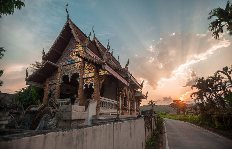 Traditional building against sky during sunset