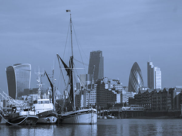 The City of London from the southern foreshore of the Thames 30 St Mary Axe Banking Cheesegrater Building City Of London London River Thames Thames Barge The Gherkin Walkie Talkie Building