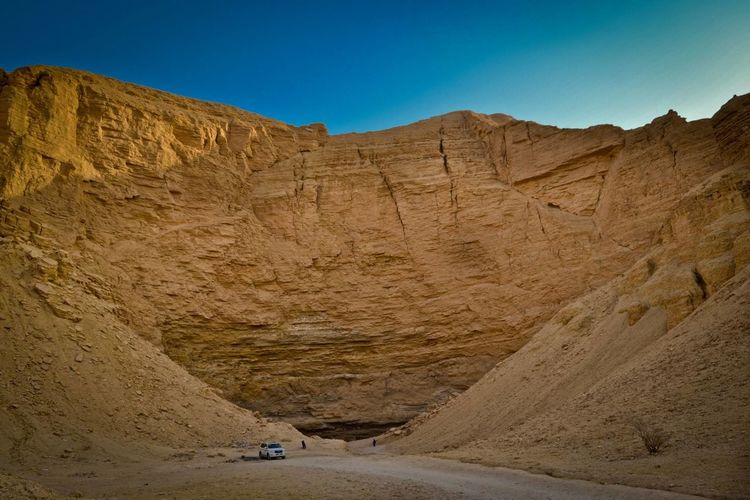 The Path Hole to History Arab World Arid Climate Beauty In Nature Cave Entrance Caves Photography Clear Sky Day Desert Landscape Middle East Mountain Nature No People Outdoors Physical Geography Saudia Scenics Sky