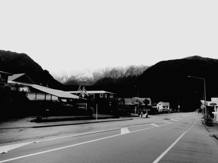Views cleared up in Fox Glacier town. Nature Mountain Landscape Travel Destinations Monochrome Blackandwhite B&w Road Clear Sky Sky Road Marking Empty Road