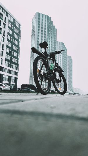Low angle view of man riding bicycle on building