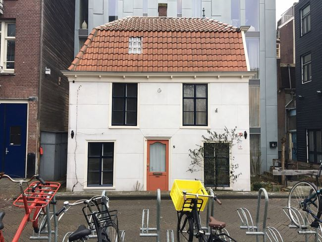Little house in Amsterdam city center surrounded by new development Architecture No People Amsterdam Lonely House Contrasting Colors Minimalism Architecture Lines And Shapes