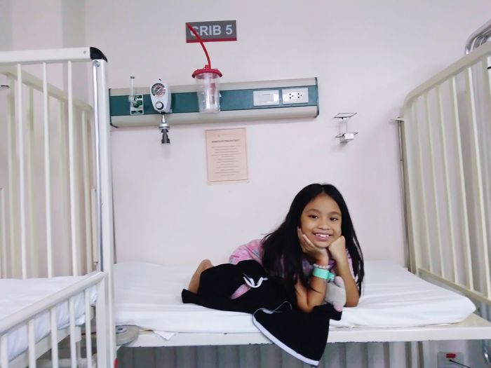 Portrait Of Girl On Bed In Hospital
