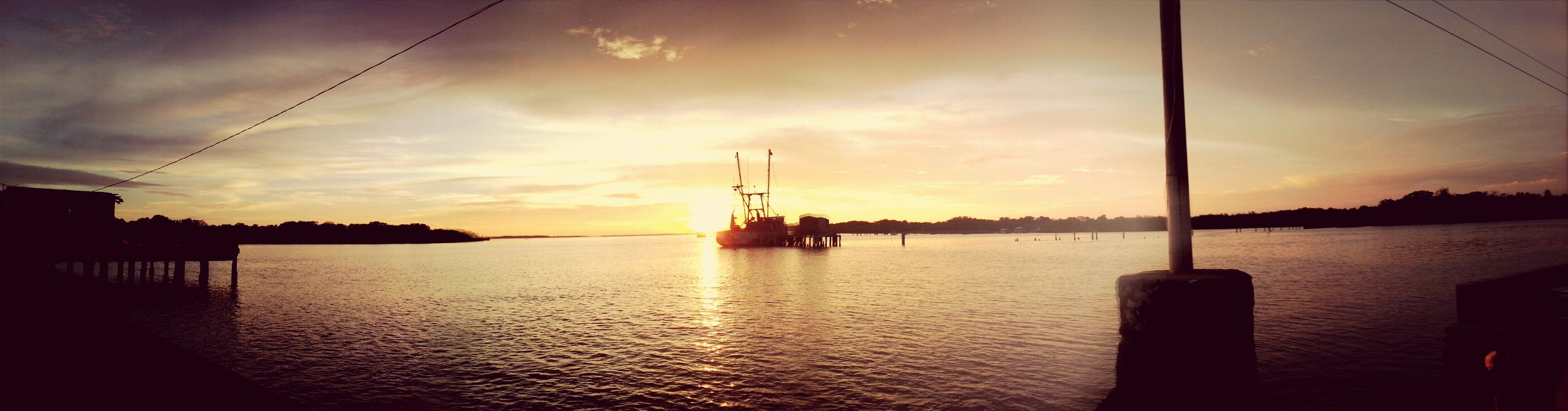 sunset, water, sky, sea, silhouette, cloud - sky, scenics, tranquil scene, tranquility, nautical vessel, beauty in nature, cloud, nature, rippled, waterfront, transportation, reflection, built structure, idyllic, orange color
