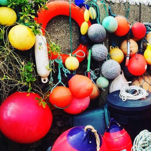 Close-up of colorful buoys on wall