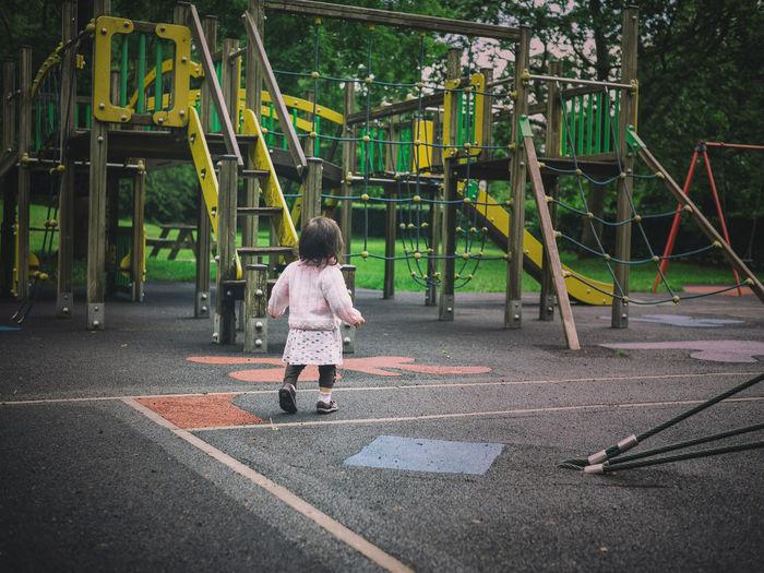 Girl Walking At Playground