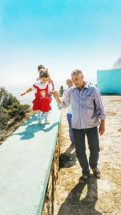 Seeing this hearttouching scene at the top of Mountain St.cruise at Oran. HeartTouching Oran  Father And Daughter Algeria Algerian Girl Warmth Streetphotography Mountain Bluesky And Bluesea