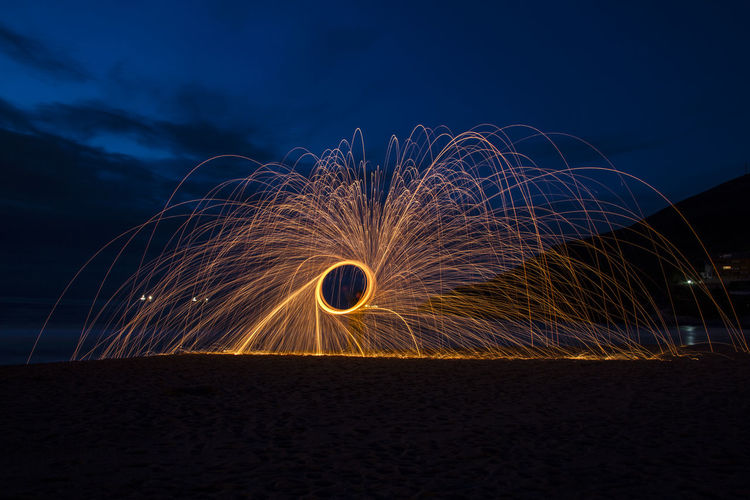 Long exposure with Steel wool Illuminated Lana De Acero Larga Exposicion Long Exposure Motion Nature Night Outdoors Sky Steel Wool Steel Wool Photography Wire Wool Wool Be. Ready.