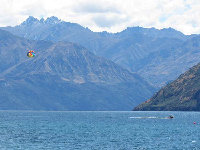 Para sailing in Wanaka lake Mountain Scenics - Nature Mountain Range Beauty In Nature Water Transportation Cloud - Sky Nature Mode Of Transportation Non-urban Scene Nautical Vessel Tranquil Scene Tranquility Day Sea Sky Travel Environment Waterfront No People
