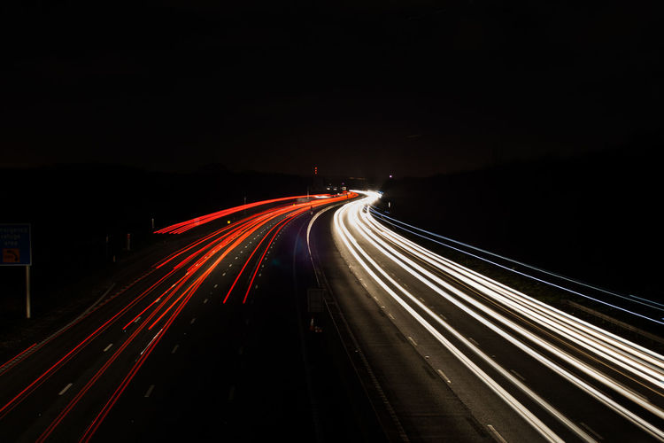 Blurred Motion Busy City Life Dark Diminishing Perspective High Angle View Illuminated Light Trail Long Exposure Motion Night Outdoors Outline Red Road Sky Speed Tail Light The Way Forward Transportation Vanishing Point