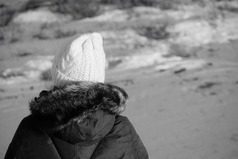 Rear view of woman looking at beach