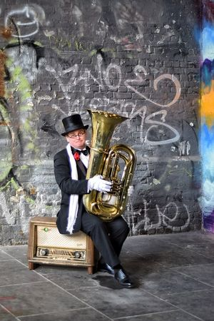 Street Musician Musician Music One Man Only Sitting People Adult One Person Musical Instrument Day Gramophone Outdoors Cultures Full Length Trombone Suited Dapper Top Hat Scarf Graffiti London Entertainer People Watching Adults Only Men TakeoverMusic