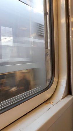 Train View From A Train Fast Train Capturing Motion Blur Blurred Motion People People Sitting Blurred People