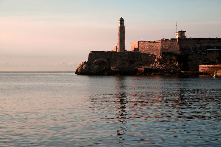 Been There. El Malecón, La Havana Havana, Cuba Havanna, Cuba Malecon Architecture Beauty In Nature Building Exterior Built Structure Day Lighthouse Nature No People Outdoors Scenics Sea Sky Sunset Tranquility Water Waterfront