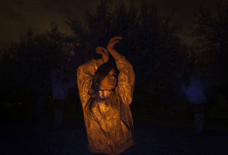 Color Double Exposure Lifestyles Light Painting Long Exposure Model Night One Person Orange Color Outdoors Real People Tree Young Adult