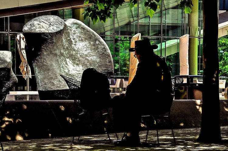 Streetphotography Streetphoto_color Light And Shadow Sunny Day Man Sitting Contemplating Trees Lincoln Center NYC Plaza Urbanphotography Urban Lifestyle UrbanART Urban Oasis NYC Photography Thenewyorker Peace And Quiet Check This Out Walking Around Urbansculpture Beautiful redesigned people friendly plaza within the Lincoln Center are that provides a respite from the hectic pace of NYC life. Silhouette