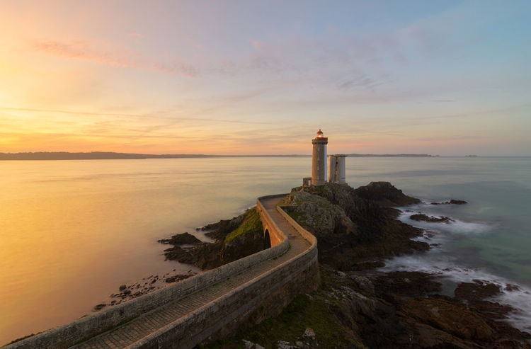 Beautiful sunrise at Le Petit Minou lighthouse Atlantic Ocean Bretagne Brittany Colors France Travel Architecture Beauty In Nature Bridge Bridge - Man Made Structure Lighthouse No People Outdoors Petit Minou Phare Scenics Sea Sunrise Travel Destinations Water