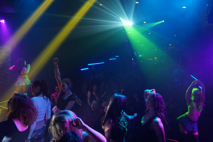 Arts Culture And Entertainment Concert Crowd Enjoyment Event Illuminated Indoors  Large Group Of People Leisure Activity Lifestyles Music Night Nightlife Performance Person Popular Music Concert Stage - Performance Space Women Women Dancing Together Youth Culture