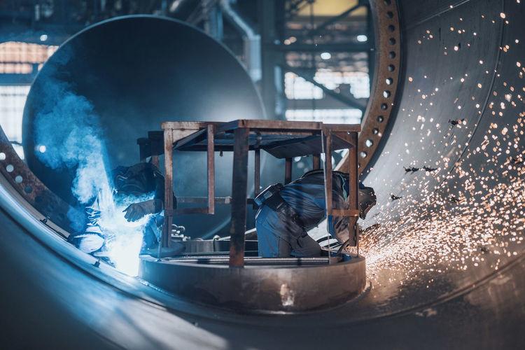 Men working on metal in factory