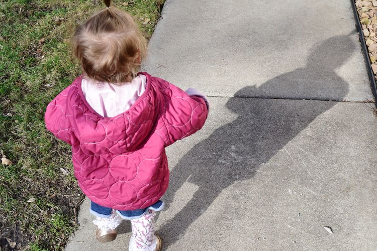 little girl walking down sidewalk with shadow Bradleywarren Photography Bradley Olson Room For Text Room For Copy Copy Space Copyspace Backgrounds Background Minnesota Minneapolis Girl Child Little Girl Children Toddler  Childhood Girls Child Shadow Pink Color High Angle View Sunlight Rear View Children Preschooler Caucasian Energetic Single Parent Head And Shoulders FootPrint