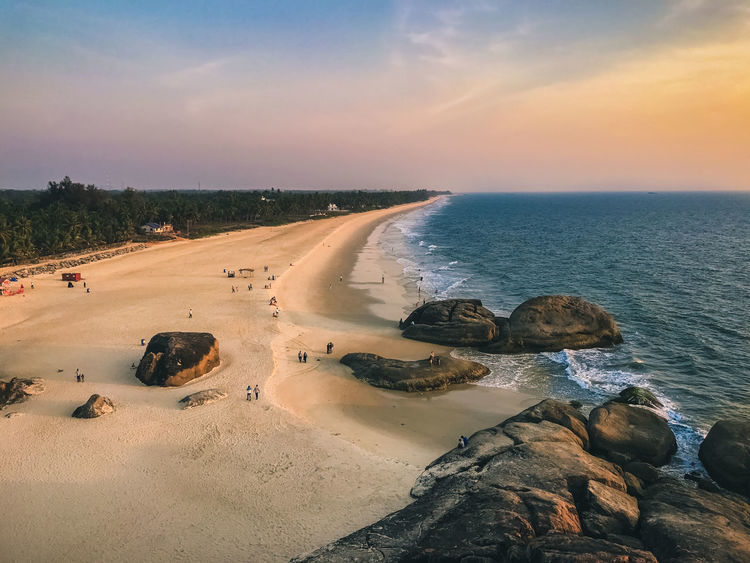 One of the cool places to hang around Udupi - Kaup Beach Colors Holiday Lighthouse Mangalore Seashore Travel Vacations Aerial View Beach Evening Sky Horizon Over Water Kaup Ocean Outdoors Rocks Rocks And Water Sand Scenics Sea Sky Sunset Tourism Tranquil Scene Tranquility Water